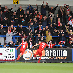 TELFORD COPYRIGHT MIKE SHERIDAN 23/3/2019 - GOAL. Orient fans celebrate wildly after Josh Coulson of Orient scores to make it 2-1 during the FA Trophy Semi Final fixture between AFC Telford United and Leyton Orient at the New Bucks Head
