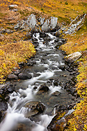 Long exposure of Palmer Creek in the high alpine of the Kenai Mountains. Autumn. Afternoon.