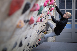 © Licensed to London News Pictures. 12/04/2021. London, UK. A climber attempts a route at Blocfit climbing gym in Brixton, South London. From today gyms, non essential retail and theme parks can reopen following the easing of lockdown restrictions. Photo credit: George Cracknell Wright/LNP