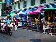 01 AUGUST 2018 - BANGKOK, THAILAND:     A vender waits for code enforcement officers to issue citations to venders on Khao San Road in Bangkok. Khao San Road is Bangkok's original backpacker district and is still a popular hub for travelers, with an active night market and many street food stalls. The Bangkok municipal government went through with it plans to reduce the impact of the street market on August 1 because city officials say the venders, who set up on sidewalks and public streets, pose a threat to public safety and could impede emergency vehicles. Venders are restricted to working from 6PM to midnight and fewer venders will be allowed to set up on the street. It's the latest in a series of night markets and street markets the city has closed.     PHOTO BY JACK KURTZ
