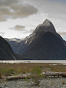 Low-angle view of Mitre Peak at sunset from Milford Sound; Fiordland National Park, New Zealand