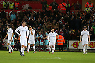 Swansea city players and Leon Britton, the captain (c)  stand dejected as they concede another goal. Premier league match, Swansea city v West Ham United at the Liberty Stadium in Swansea, South Wales on Boxing Day, Monday 26th December 2016.<br /> pic by  Andrew Orchard, Andrew Orchard sports photography.