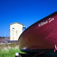 North America, Canada, Nova Scotia, Canso. Red boat in Canso.