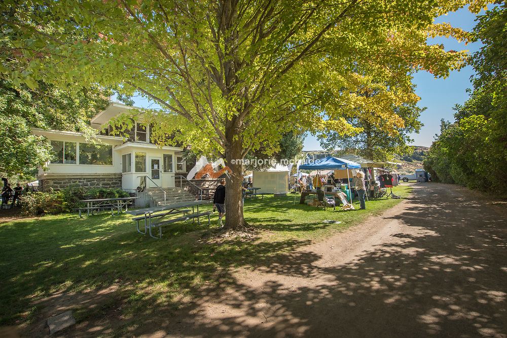 Historic building with art vendors at the Thousand Springs Art Festival at Ritter Island near Hagerman, Idaho.