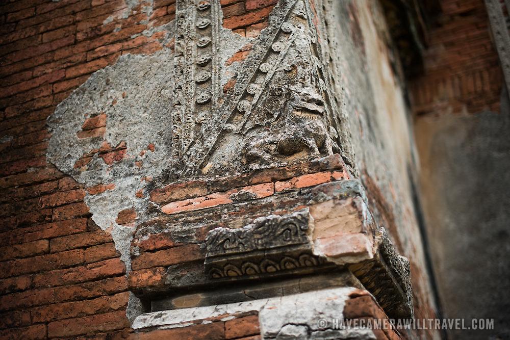 Part of the weathered decorative exterior of Gu-byauk-gyi Temple in Nyaung-U, Myanmar (Burma).