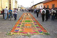 Alfombras are brightly coloured carpets made of flowers.  This Easter custom in Guatemala is incredibly beautiful going back to the Spanish who then used colorful street decorations at Easter.  The colorful  use of carpets of  flowers has its beginnings in the Mayan custom of creating pathways for kings and priests to walk on when entering ceremonial locations and for use in sacred spaces.  In the alfombras of Guatemala you see a mix of both.