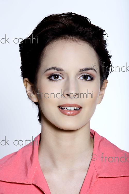 studio shot portrait on grey background of a  Beautiful smiling French Women looking like isabella rosselini or juliette binoche