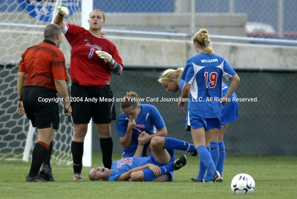 29 October 2004: Senior defender Stacy Leeper (18) is tended to after suffering a game-ending injury in the second half. Kansas defeated Iowa State 4-0 in Lawrence, KS to clinch the Big XII Conference Womens Soccer Championship..