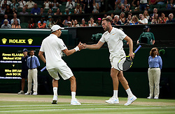 Mike Bryan and Jack Sock (right) celebrate winning the Gentlemen's Doubles final on day twelve of the Wimbledon Championships at the All England Lawn Tennis and Croquet Club, Wimbledon. PRESS ASSOCIATION Photo. Picture date: Saturday July 14, 2018. See PA story TENNIS Wimbledon. Photo credit should read: Jonathan Brady/PA Wire. RESTRICTIONS: Editorial use only. No commercial use without prior written consent of the AELTC. Still image use only - no moving images to emulate broadcast. No superimposing or removal of sponsor/ad logos. Call +44 (0)1158 447447 for further information.