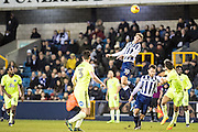 Millwall forward Harry Smith (30), Millwall forward Lee Gregory (9), Peterborough United defender Andrew Hughes (3), Peterborough United defender Ryan Tafazolli (5) during the EFL Sky Bet League 1 match between Millwall and Peterborough United at The Den, London, England on 28 February 2017. Photo by Sebastian Frej.