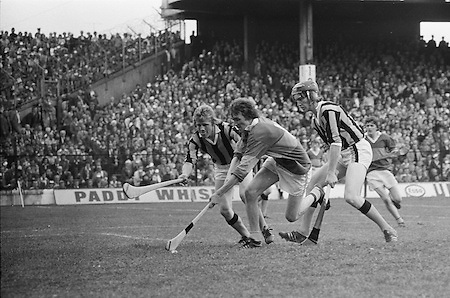 Tipperary is outnumbered as he gains possession of the slitor in front of the Kilkenny goalmouth during the All Ireland Minor Hurling Final, Tipperary v Kilkenny in Croke Park on the 5th September 1976.