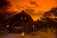 The sunsets behind bomas (guest cottages), Serengeti Serena Lodge, Serengeti National Park, Tanzania