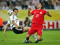 v.l. Christoph Metzelder, Ireneusz Jelen Polen<br /> Fussball WM 2006 Deutschland - Polen<br /> Tyskland - Polen<br /> Norway only