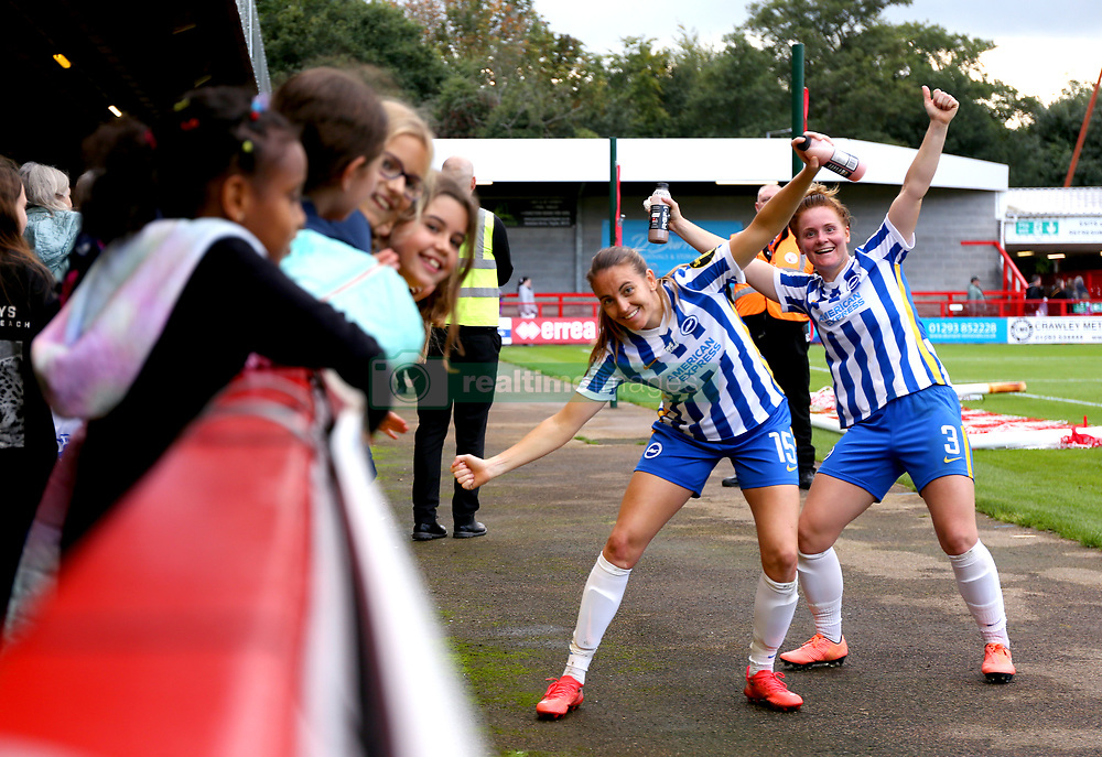 Brighton and Hove Albion's Felicity Gibbons (right) and Kayleigh Green celebrate with the fans at the end of the FA Women's Super League match at the People's Pension Stadium, Crawley. Picture date: Sunday October 10, 2021.