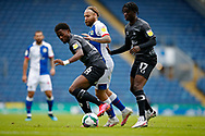 Harry Chapman of Blackburn Rovers  is crowded out by Madger Gomes of Doncaster Rovers and Taylor Richards of Doncaster Rovers  during the EFL Cup match between Blackburn Rovers and Doncaster Rovers at Ewood Park, Blackburn, England on 29 August 2020.