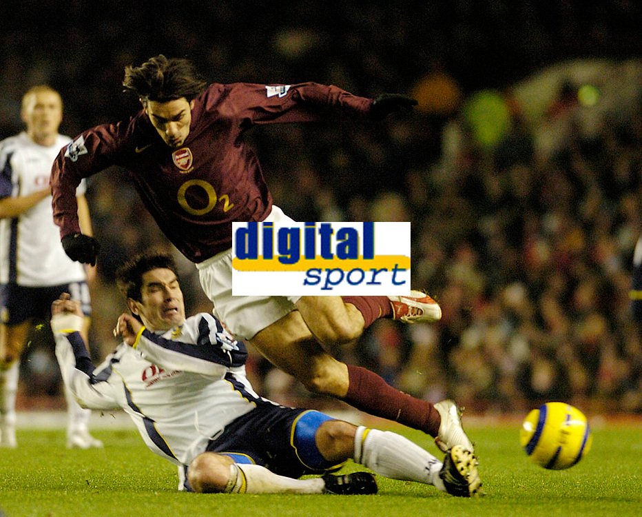 Photo: Leigh Quinnell.<br /> Arsenal v Portsmouth. The Barclays Premiership.<br /> 28/12/2005. Portsmouths Richard Hughes sends Arsenals Robert Pires flying.