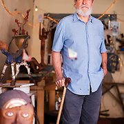"""Art Herman's studio is located in a small dark room behind a gallery space in a converted garage on Main Street. He walks with a cane due to a bad back, most likely from years of hard labor working as a commercial diver, a carpenter, an electrician and a plumber. He works with his hands, always has. As a full-time artist, Herman is putting those hands to work sculpting wood and bending metals and found objects. His most recent project is a personal one. Herman, a kind and soft spoken man, is entering a new chapter in his life as an artist and his political views are a big part of that. His latest work — wood sculptures of crows — is a statement against Nevada's open season hunting of crows, which he affectionately calls """"little darlings."""" This new found activism doesn't seem like a stretch for a man man who discovered his passion for art while stationed in San Francisco during the 60s at the height of the Beat Movement."""