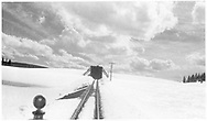 """View through an RGS Goose windshield southbound approaching the Lizard Head Pass snowshed.<br /> RGS  Lizard Head, CO  Taken by Dunscomb, Guy L. - 1941<br /> In book """"Southern, The: A Narrow Gauge Odyssey"""" page 65"""