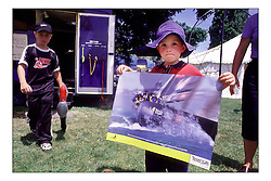 A child in Arrowtown in New Zealand's South Island, collects his Team New Zealand Poster as part of the touring promotion for the upcoming America;s Cup defence...New Zealand, a country that absorbs their sportng achievements into legend. The America's Cup, the oldest sporting trophy,  won and retained by an NZ based syndicate, with considerable state aid and of course the support of the people, in their droves...Marc Turner / PFM