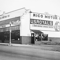 A photograph of Rico Motor Company at their old location in the Goodyear building on Coal Street.
