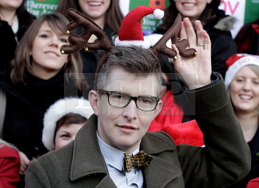 © Licensed to London News Pictures. 20/12/2011. London, United Kingdom .Gareth Malone wears a silly hat with the Military Wives Choir outside of HMV on Oxford Street to celebrate the success of the Military Wives single..Photo credit : Chris Winter/LNP