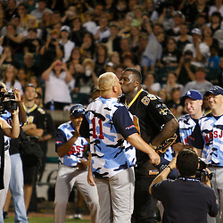 Apr 28, 2010; Metairie, LA, USA; New Orleans Saints defensive end Anthony Hargrove (69) kisses NASJRB All Stars player Martin McKinney (11) after he hit a home run during the Heath Evans Foundation charity softball featuring teammates of the Super Bowl XLIV Champion New Orleans Saints at Zephyrs Field.  Mandatory Credit: Derick E. Hingle-US-PRESSWIRE.
