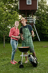 Young couple barbecue grill garden beer