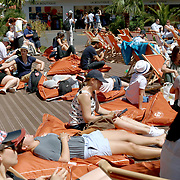 2017 French Open Tennis Tournament - Day Fourteen.  Fans relax in front of a big screen on deck chairs and bean bags at the 2017 French Open Tennis Tournament at Roland Garros on June 10th, 2017 in Paris, France.  (Photo by Tim Clayton/Corbis via Getty Images)