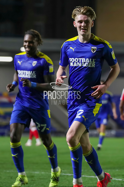 GOAL 1-0, AFC Wimbledon midfielder Jack Rudoni (12) about to celebrate during the EFL Sky Bet League 1 match between AFC Wimbledon and Gillingham at Plough Lane, London, United Kingdom on 23 February 2021.