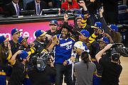 A Golden State Warriors fan celebrates making a half-court shot and winning $5,000 during a timeout against the Utah Jazz at Oracle Arena in Oakland, Calif., on December 20, 2016. (Stan Olszewski/Special to S.F. Examiner)
