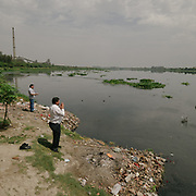 Men come to pray and empty their home's temple garbages into the Yamuna. By the ITO bridge, people come to offer prayers at the Yamuna river, a holy river to Hinduism. At the point, having received over 15 untreated sewer drains, the Yamuna is essentially a dead river.