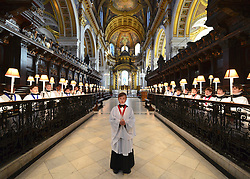 © Licensed to London News Pictures. 10/12/2012. City of London, UK Harry Jackson, 13, the oldest member of the choir singing holding a candle.  A photo call for St Paul's Choristers preparing for their busiest weeks of the year. The choristers will rehearse Christmas favourites, under the direction of Andrew Carwood, Director of Music. St Paul's Cathedral. today 10 December 2012. On Christmas Eve the Choristers will sing a carol service at 4pm followed by traditional Midnight Eucharist at 11.30pm, They will then sing on Christmas day before lunch at school.  Photo credit : Stephen Simpson/LNP