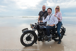 Paul D'Orleans on Bryan Bossier's 1933 Brough Superior 11-50 on the sand with his passenger Susan McLaughlin and co-rider Alan Stulberg before the start of stage 1 of the Motorcycle Cannonball Cross-Country Endurance Run, which on this day ran from Daytona Beach to Lake City, FL., USA. Friday, September 5, 2014.  Photography ©2014 Michael Lichter.