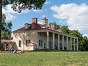 Mount Vernon, Virginia, was the plantation home of George Washington, the first President of the United States (1789-1797). The mansion is built of wood in neoclassical Georgian architectural style on the banks of the Potomac River. Mount Vernon estate was designated a National Historic Landmark in 1960 and is owned and maintained in trust by The Mount Vernon Ladies' Association. The estate served as neutral ground for both sides during the American Civil War, although fighting raged across the nearby countryside. George Washington, who lived 1732-1799, was one of the Founding Fathers of the United States of America (USA), serving as the commander-in-chief of the Continental Army during the American Revolutionary War, and presiding over the convention that drafted the Constitution in 1787. Named in his honor are Washington, D.C. (the District of Columbia, capital of the United States) and the State of Washington on the Pacific Coast.