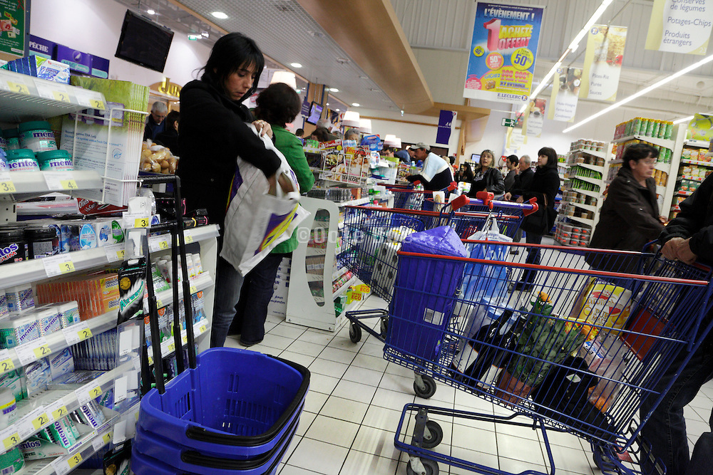 waiting inline by the cashier of a supermarket