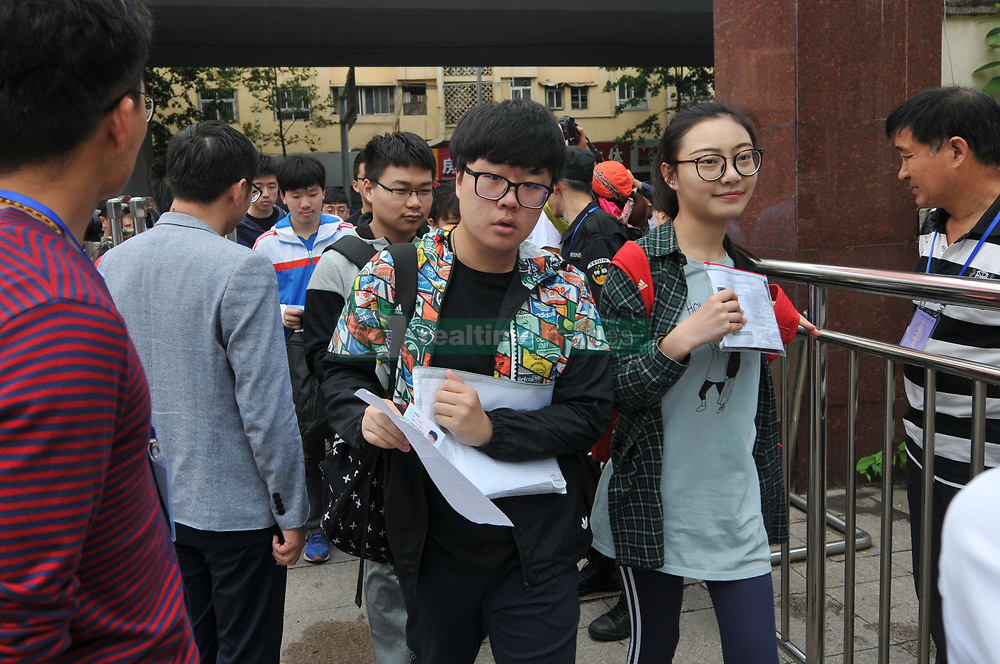 June 7, 2017 - Qingdao, Qingdao, China - Qingdao, CHINA-June 7 2017: (EDITORIAL USE ONLY. CHINA OUT) ..Examinees outside an examination site in Qingdao, east China's Shandong Province, June 7th, 2017. About 35,000 students attend the National College Entrance Examination in Qingdao. (Credit Image: © SIPA Asia via ZUMA Wire)