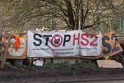 Harefield, UK. 17 January, 2020. A banner at Stop HS2's Colne Valley protection camp in the Colne Valley. Activists from Stop HS2 and Extinction Rebellion are beginning a three-day 'Stand for the Trees' protest there timed to coincide with tree felling work by HS2. Bailiffs acting for HS2 have been evicting Stop HS2 activists from the camp for the past week and a half. 108 ancient woodlands are set to be destroyed by the high-speed rail link.