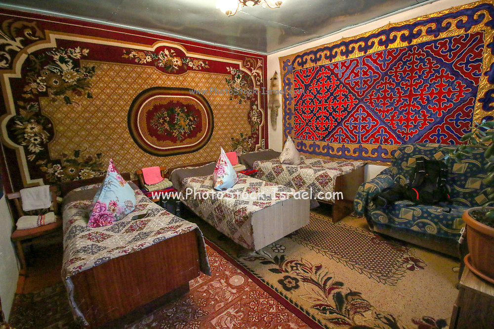 Kyzyl-Oi village (red village or red bowl), Kyrgyzstan Interior of a home - the bedroom