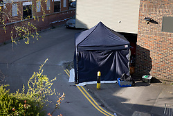 © Licensed to London News Pictures. 23/04/2021. Walton-on-Thames, UK. A police evidence tent remains in the car park of a Marks and Spencer store in Walton-on-Thames after a man was killed in an altercation. Police were called to Church Street around 2.15pm on 22/04/2021 following reports that an altercation had taken place between a group of men. One of the men then got into his car, a white 1 series BMW, and is reported to have driven at two of the other men in the group.  One man was killed and another injured. The driver of the car has been arrested on suspicion of murder and attempted murder. Photo credit: Peter Macdiarmid/LNP