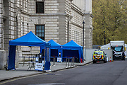 """A """"search tent"""" is seen inside the Commonwealth office as aeavy police deployment is concentrated across central London on Saturday, May 1, 20201 - ahead of dozens of marches and protests announced to oppose government among others in the police and crime sentencing bill. (Photo/ Vudi Xhymshiti)"""