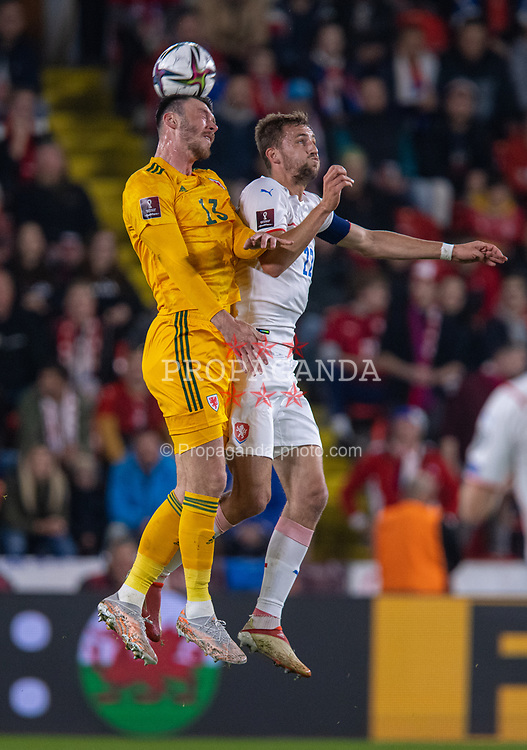 PRAGUE, CZECH REPUBLIC - Friday, October 8, 2021: Wales' Kieffer Moore (L) challenges for a header with Czech Republic's captain Tomáš Souček during the FIFA World Cup Qatar 2022 Qualifying Group E match between Czech Republic and Wales at the Sinobo Stadium. The game ended in a 2-2 draw. (Pic by David Rawcliffe/Propaganda)
