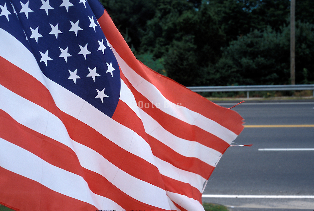 American flag with the road beyond