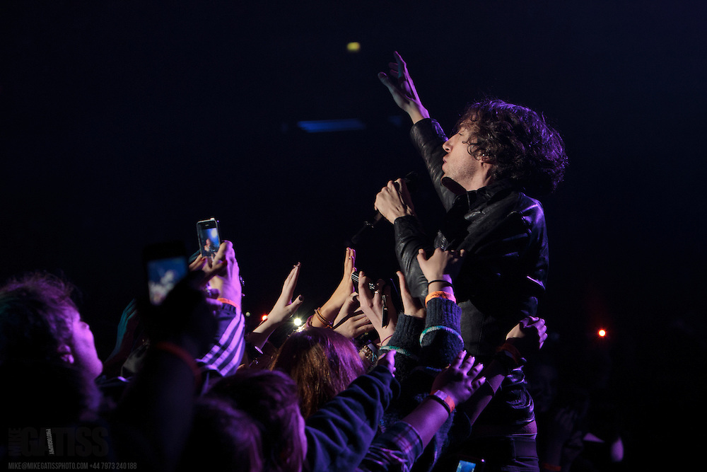 Gary Lightbody of Snow Patrol gets down among the fans whilst performing live on their Fallen Empires Tour at Liverpool Arena, 2012-01-31
