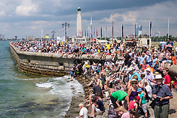 © Licensed to London News Pictures. 22/07/2016. Portsmouth, United Kingdom.  Spectators watch practice for the America's Cup World Series (ACWS) in Portsmouth this weekend, 22nd-24th July 2016. British Olympic sailing legend, Sir Ben Ainslie, is leading his all-British team, Land Rover BAR, against other teams in a battle to qualify for a place in the two team America's Cup final, to be held in Bermuda in 2017. Today (22/07/16) is a practice day, followed by two days of racing. Photo credit: Rob Arnold/LNP