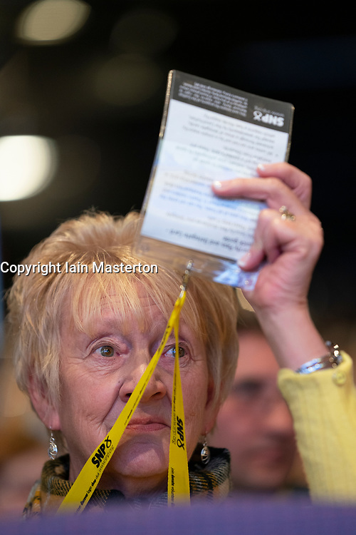 Edinburgh, Scotland, UK. 27 April, 2019. SNP ( Scottish National Party) Spring Conference takes place at the EICC ( Edinburgh International Conference Centre) in Edinburgh. Pictured; Female delegate voting during a session on day 1.