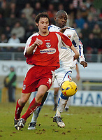 Photo: Ed Godden.<br /> <br /> Leyton Orient v Carlisle United. Coca Cola League 2. 11/02/2006. Craig Easton (Leyton Orient)left, speeds away from Chris Billy (Carlisle)