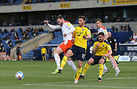 Blackpool's Oliver Turton and Oxford United's James Henry challenge for the ball<br /> <br /> Photographer Rob Newell/CameraSport<br /> <br /> Sky Bet League One Play-Off Semi-Final 1st Leg - Oxford United v Blackpool - Tuesday 18th May 2021 - Kassam Stadium - Oxford<br /> <br /> World Copyright © 2021 CameraSport. All rights reserved. 43 Linden Ave. Countesthorpe. Leicester. England. LE8 5PG - Tel: +44 (0) 116 277 4147 - admin@camerasport.com - www.camerasport.com