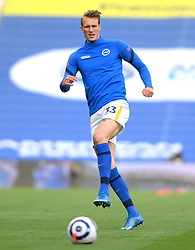 Brighton and Hove Albion's Dan Burn warming up prior to kick-off during the Premier League match at the American Express Community Stadium, Brighton. Picture date: Saturday May 15, 2021.