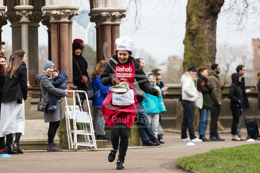 MPs and members of the House of Lords compete in the annual Rehab pancake race, a relay of eleven laps in Victoria Tower Gardens adjacent to the Houses of Parliament in London. The race is held every year on Shrove Tuesday and was won by the Media team. PICTURED: Liz Bates, DOD Parliamentary Communications. London, February 13 2018.