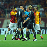 Referee's Huseyin GOCEK (C) and Galatasaray's Milan BAROS (L), Felipe MELO (R) during their Friendly soccer match Galatasaray between Liverpool at the TT Arena at Arslantepe in Istanbul Turkey on Saturday 28 July 2011. Photo by TURKPIX